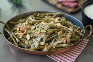 Slow cooker green beans with shallots and almonds is the easiest and most delicious holiday side dish. Taking help from the slow cooker to make things easy, green beans are slow cooked in bath of butter and vegetable stock, topped with sweet shallots and toasted almonds.