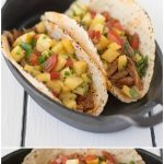 Slow cooker pineapple pepper carnitas tacos are big in name and big in flavor. Pork shoulder is slow cooked in a guajillo pepper, pineapple sauce, shredded and served in tacos with fresh pineapple salsa.