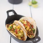 2 tacos in a cast iron pan