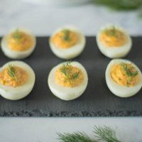 Smoked salmon deviled eggs are classic finger food. The addition of smoked salmon elevates them to an elegant bite perfect for entertaining, parties, brunch, breakfast or take to work lunch for a protein packed lunch.