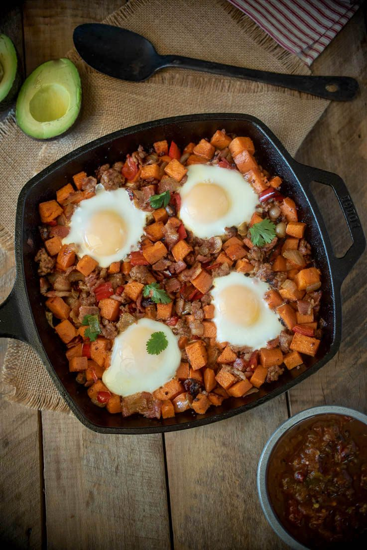 An overhead image of the breakfast skillet with fresh avocado and salsa.