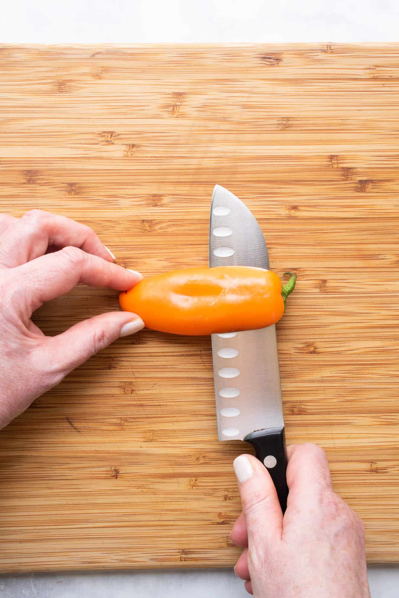 Cutting a mini pepper lengthwise