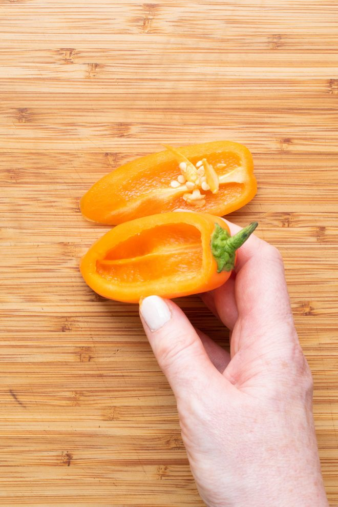 A mini sweet pepper sliced open with the seeds removed