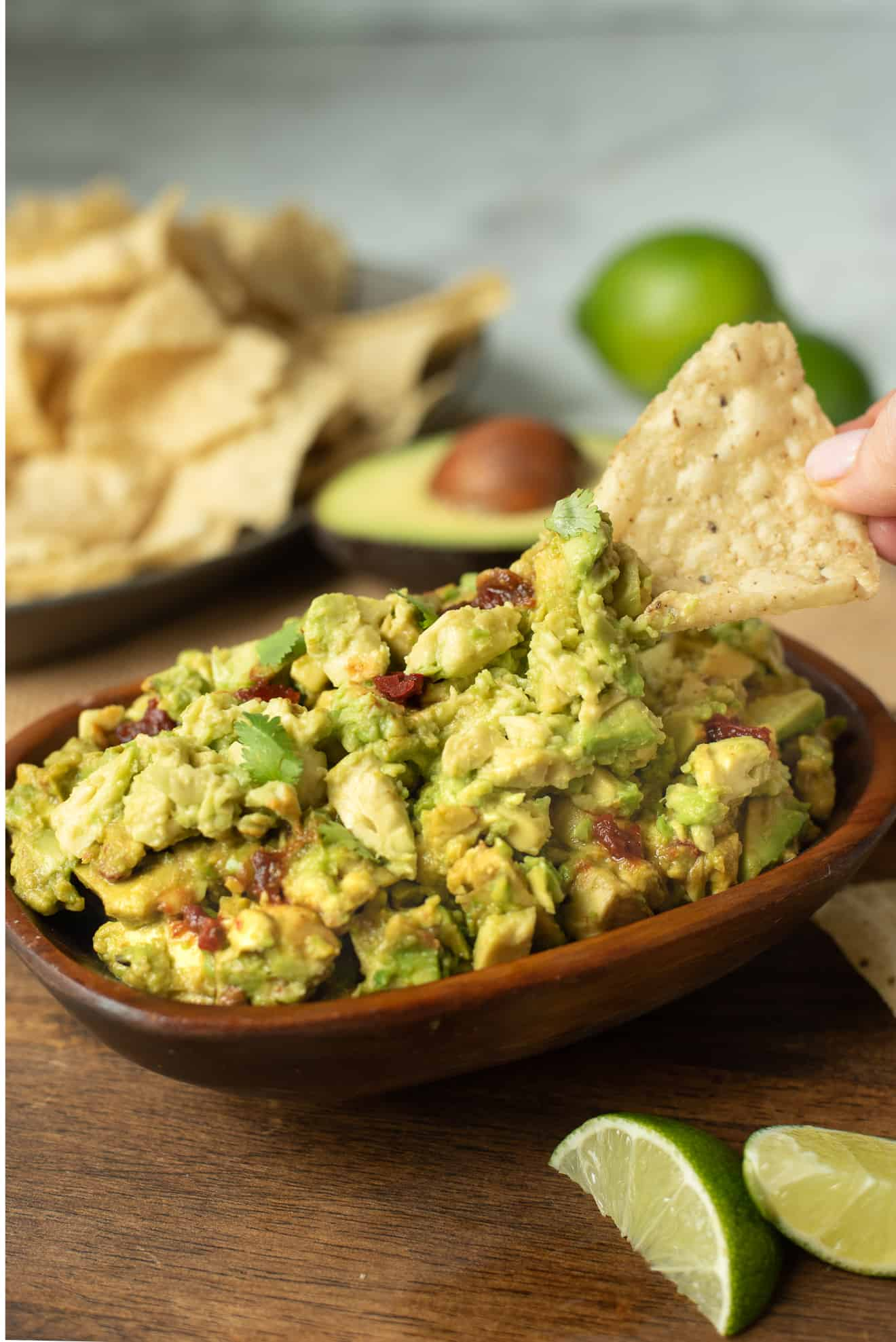 Scooping up some spicy guacamole with a tortilla chip