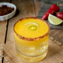 Spicy Jalapeño Mango Margarita with chili peppers and lime