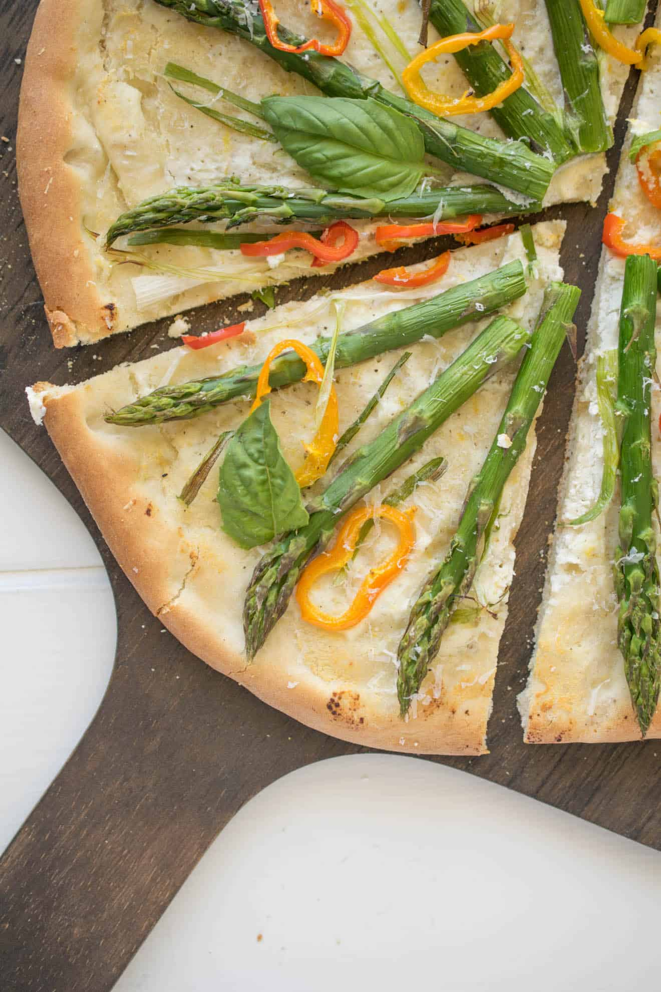A slice of spring vegetable pizza closeup