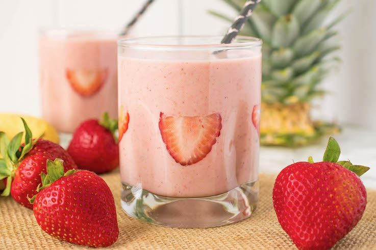 A side view showing sliced strawberries in the side of the glass