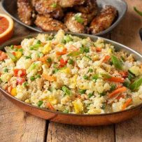 Colorful vegetable fried rice in an oval serving dish