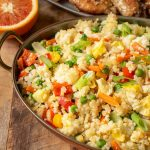 Peppers, carrots, peas and onions in fried rice