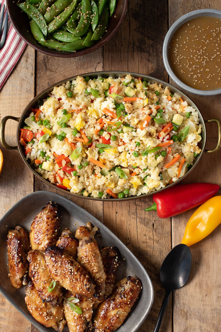 Fried rice from overhead with wings, peppers and vegetables