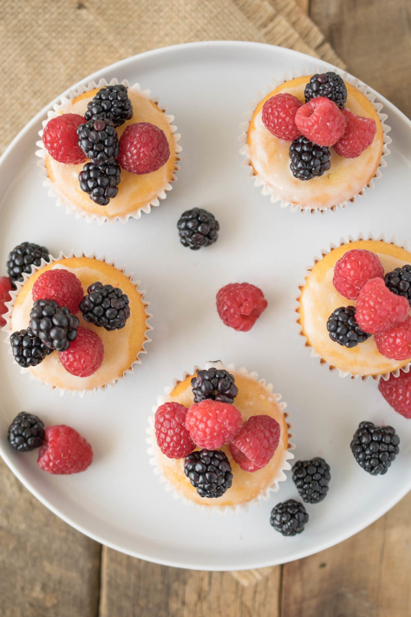 An overhead image of muffins with colorful berries