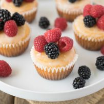 Lemon muffins topped with colorful fruit