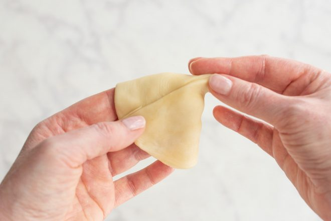 A cone shape is made using the dough