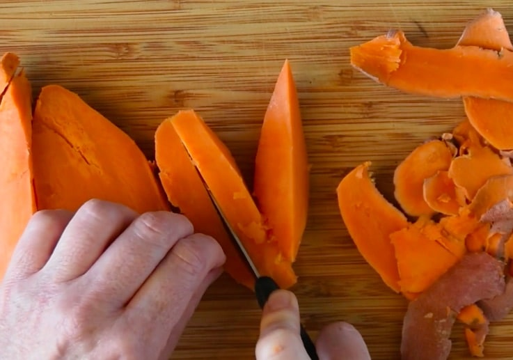 Cooked sweet potatoes being diced