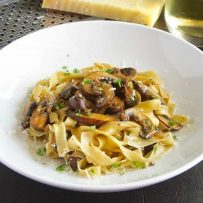 Fresh tagliatelle topped with mushrooms cooked in wine