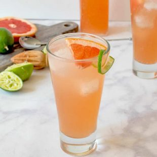 2 glass of tequila Paloma cocktail with fresh lime and grapefruit