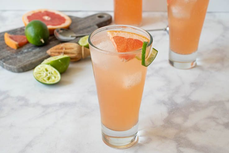 2 glasses of paloma with fresh limes and grapefruit