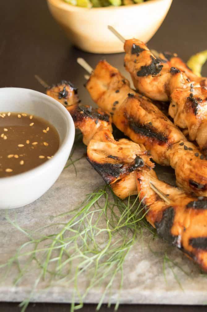 Grilled teriyaki chicken skewers with a side of teriyaki sauce