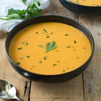A freshly served bowl of Thai butternut squash soup