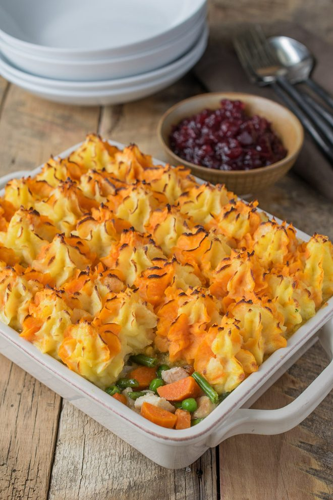 Turkey and vegetables topped with colorful mashed potato
