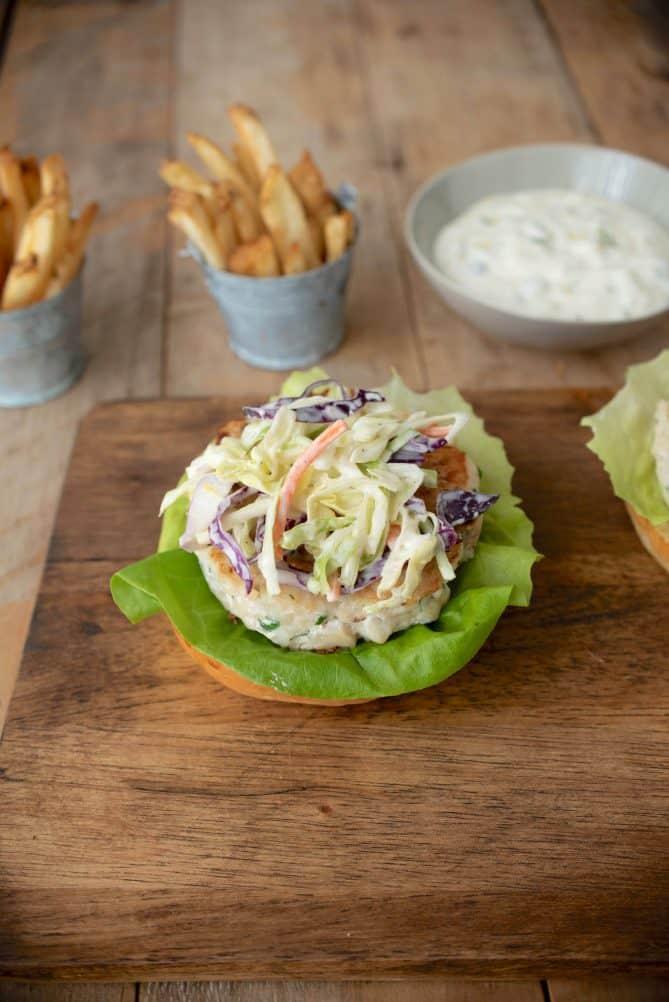 Coleslaw on top of a tilapia burger