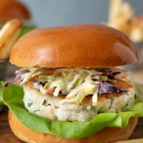 A tilapia burger viewed from the side