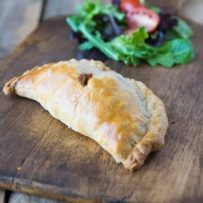 Traditional Cornish pasty are savory packages of beef and potatoes wrapped in flaky, buttery pastry. It makes a wonderful lunch or dinner on a chilly day.