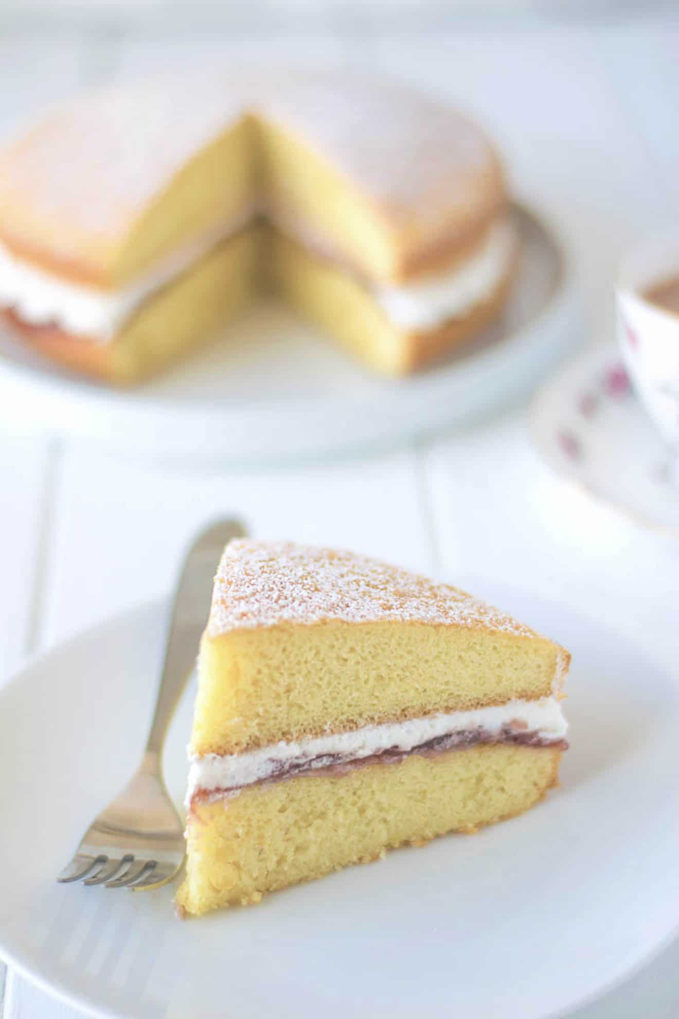 A perfect slice of cake on a white plate