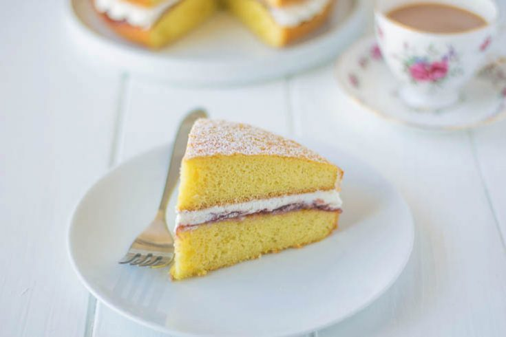 A slice of sponge cake sandwiched with jam and whipped cream
