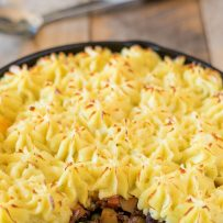 A traditional shepherd's pie in a cast iron skillet