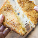 A triple grilled cheese with a is a grilled cheese with a twist. 2 cheeses on the inside of the bread and 1 cheese on the outside.