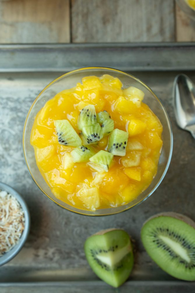 Viewed from overhead showing the vibrant mango, pineapple and kiwi toppings