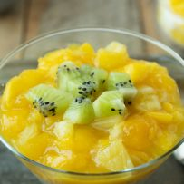 Chopped kiwi, mango and pineapple served on top of chilled rice pudding