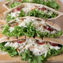 A closeup showing the crisp lettuce, tuna filling and sweet slices of grape