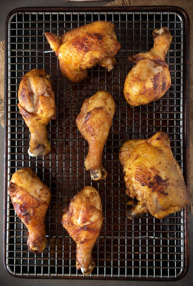 Freshly fried Turmeric Spiced Fried Chicken on a cooling rack