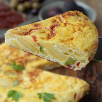 A slice of Vegetable Spanish Omelette Tortilla showing the filling