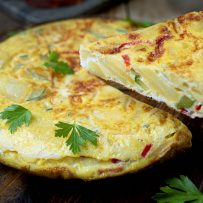 Serving a slice of potato and vegetable Spanish omelette