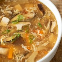A closeup of the soup showing the mushrooms, tofu and vegetables