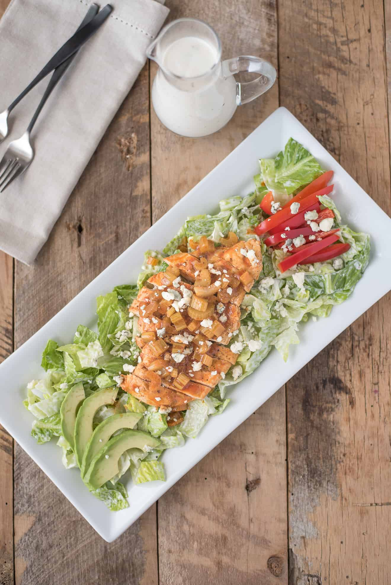 Buffalo chicken, peppers, avocado, blue cheese served over lettuce