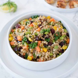 A colorful bowl of vegetable farro