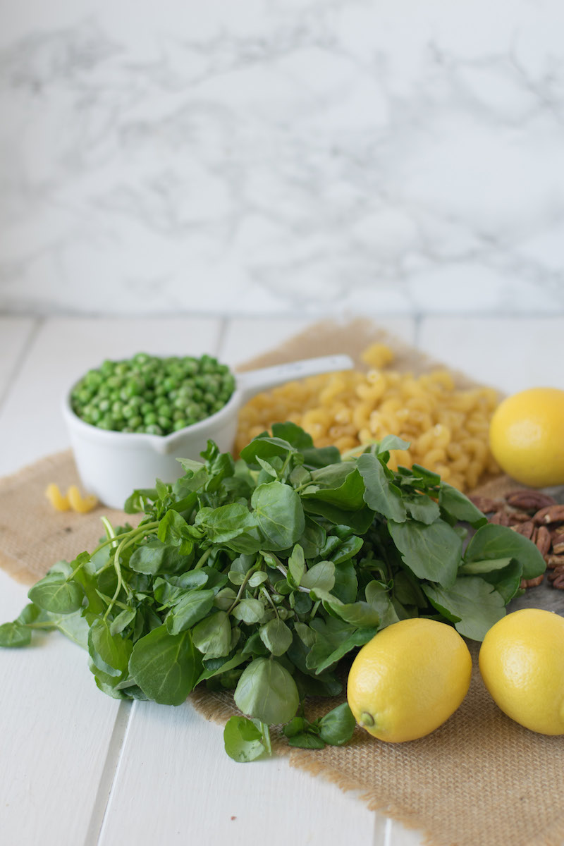 Watercress, pea and lemon pesto pasta is a fresh, bright and flavorful use of fresh ingredients. Peppery watercress paired with sweet pea and fresh lemons makes for the perfect light pesto for spring and summer.