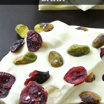 Dried cranberries, roasted pistachios are turned into Christmas bark with hardened white chocolate