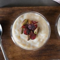 Dried cranberries and toasted pistachios on top of rice pudding