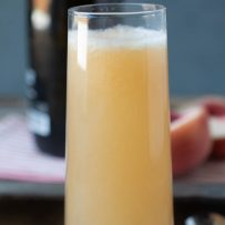 A white peach Bellini drink viewed from the side