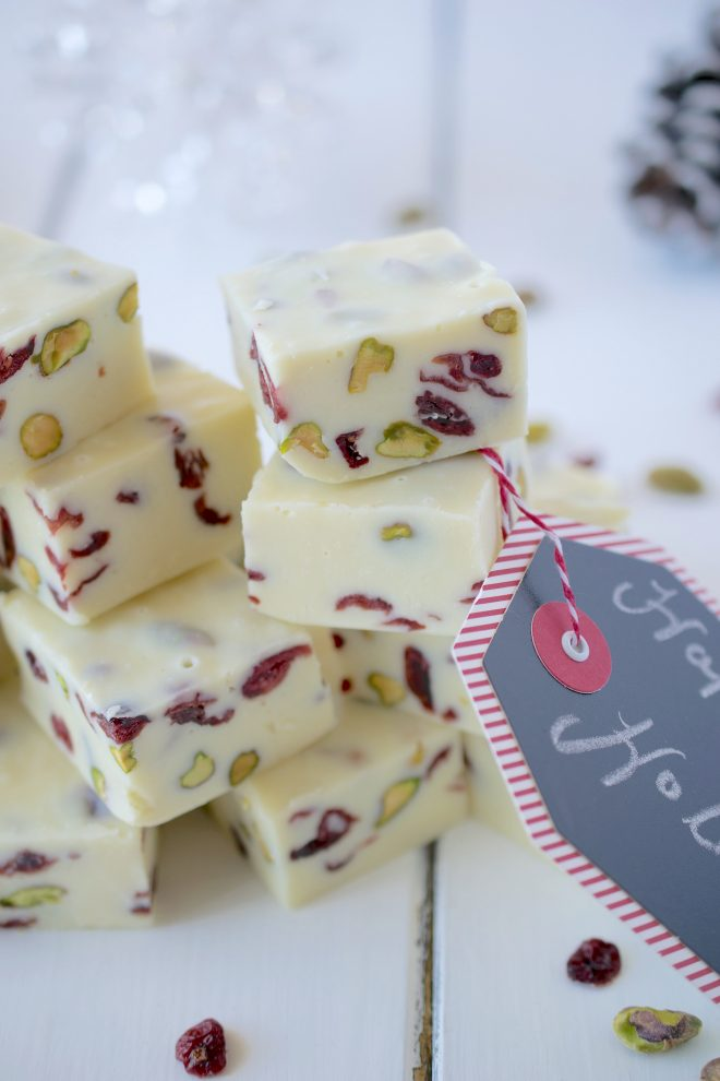 White Chocolate Pistachio Cranberry Fudge cut showing the pieces of pistachios and dried cranberries inside